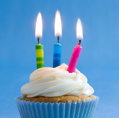 Cupcake decorated with brightly colored candles